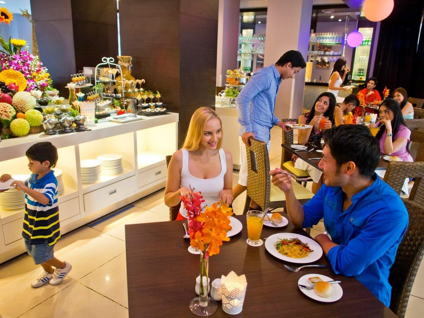 People enjoying the buffet at the Fresh Restaurant