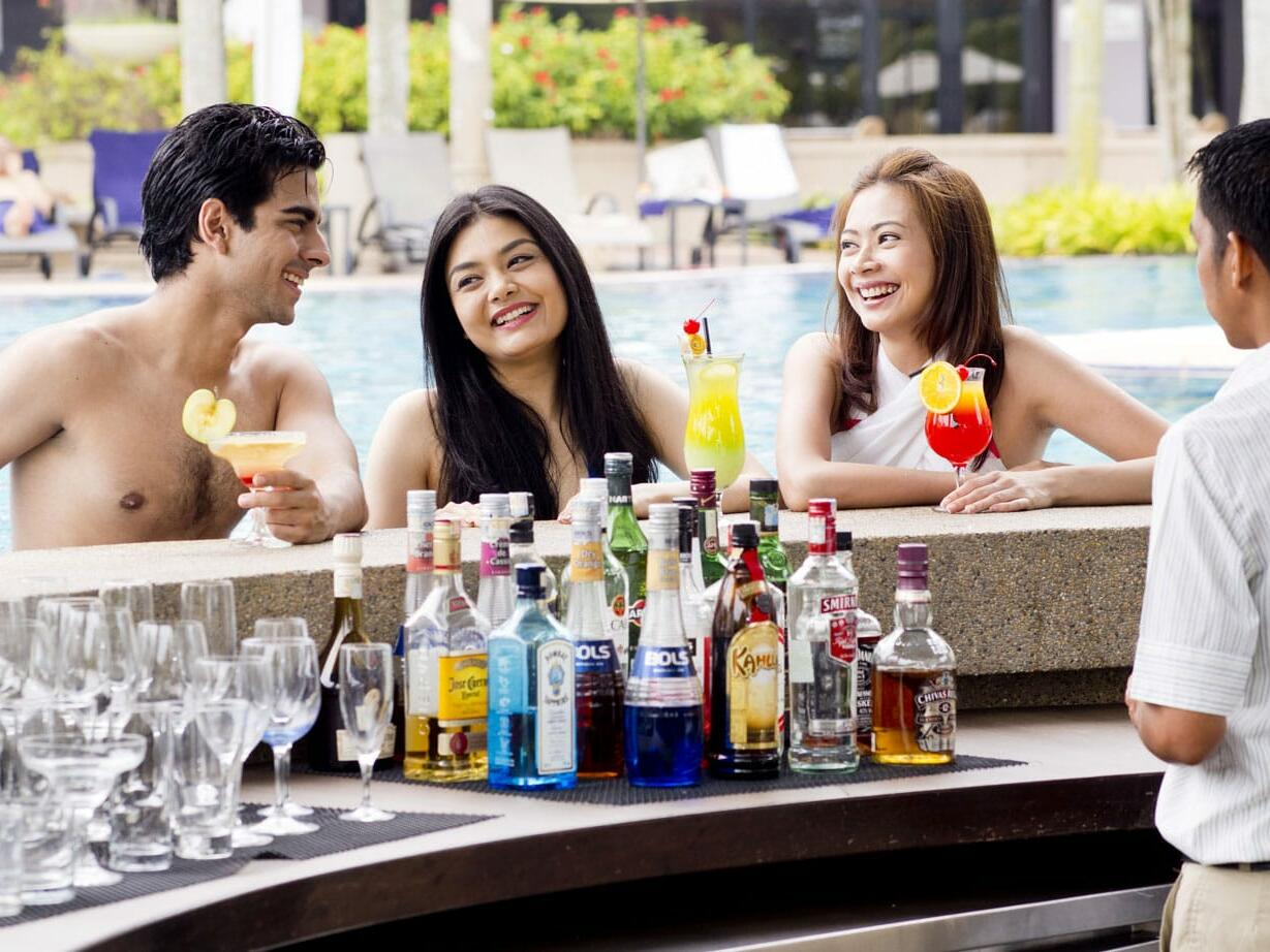 Three people enjoying drinks at the Pool Bar