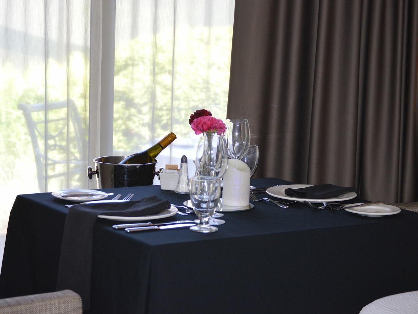 black dining table near window at The Inn of Waterloo