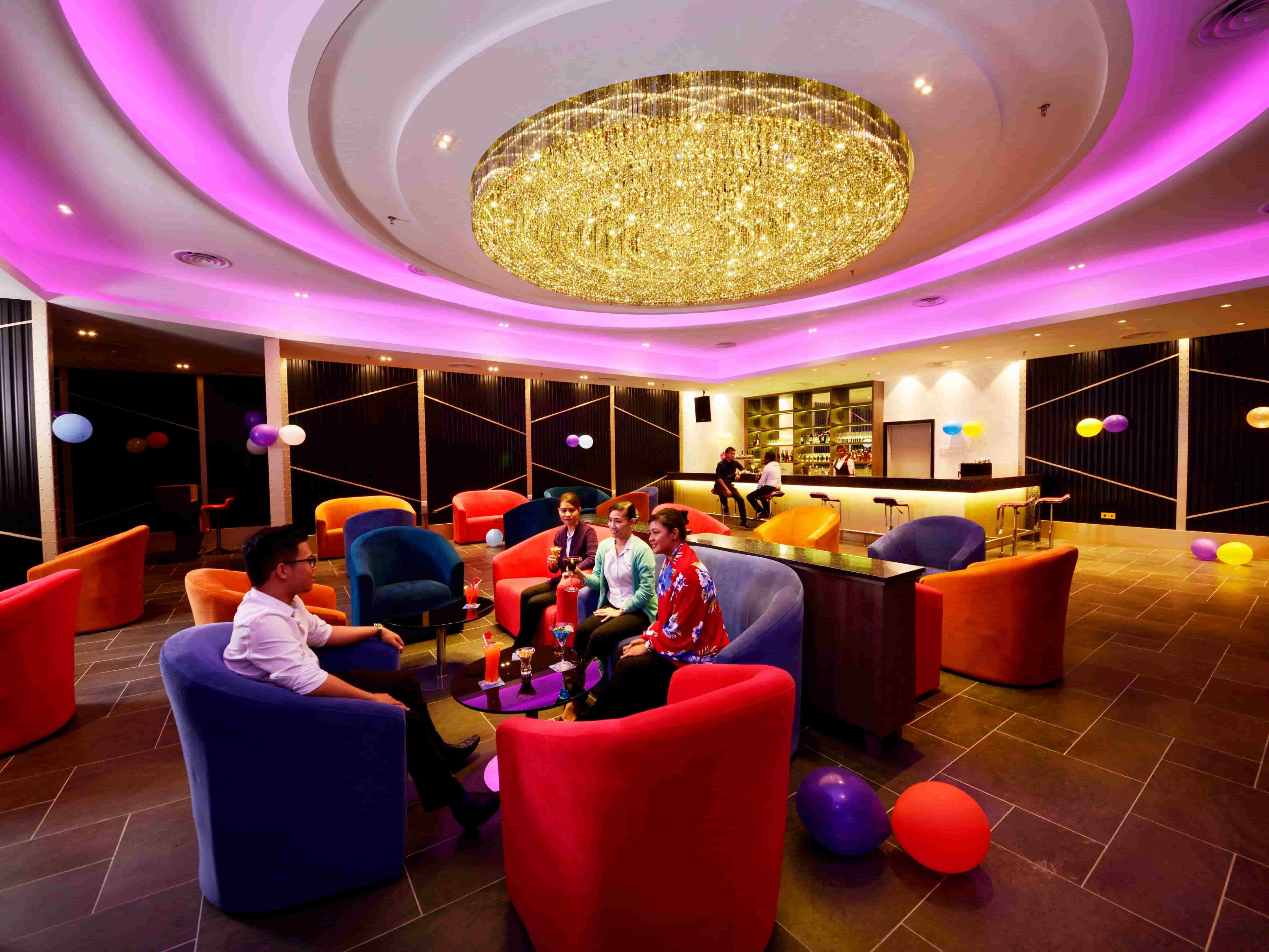 Customers enjoying happy hour at Satellite Bar, Lexis Hibiscus® Port Dickson