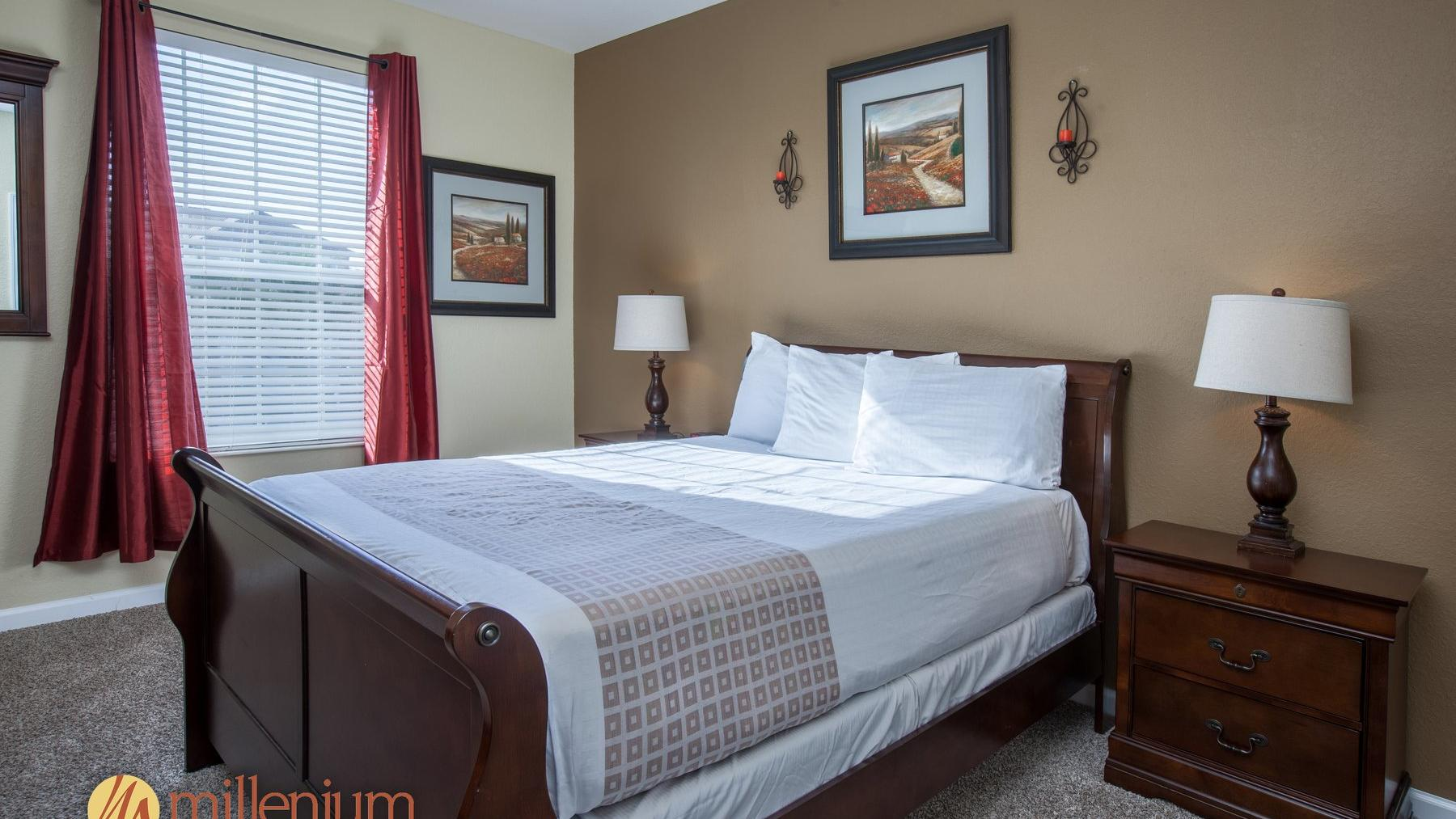 Queen bed with lamps on nightstands