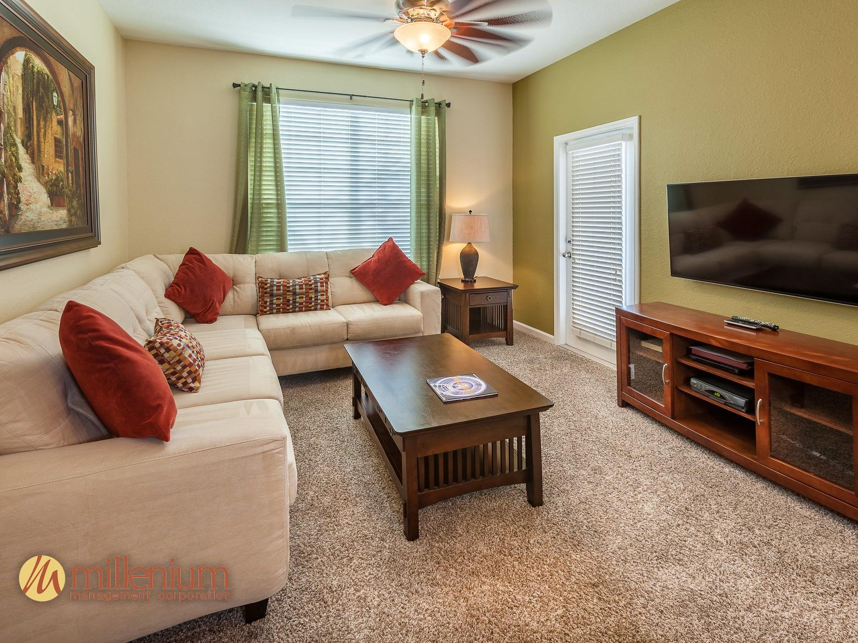 Living room with sectional sofa, coffee table and TV