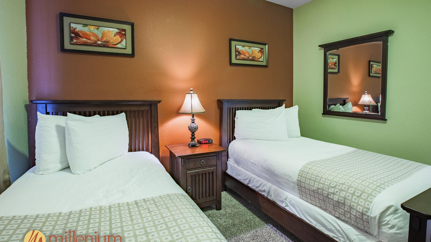 Two twin beds with nightstand