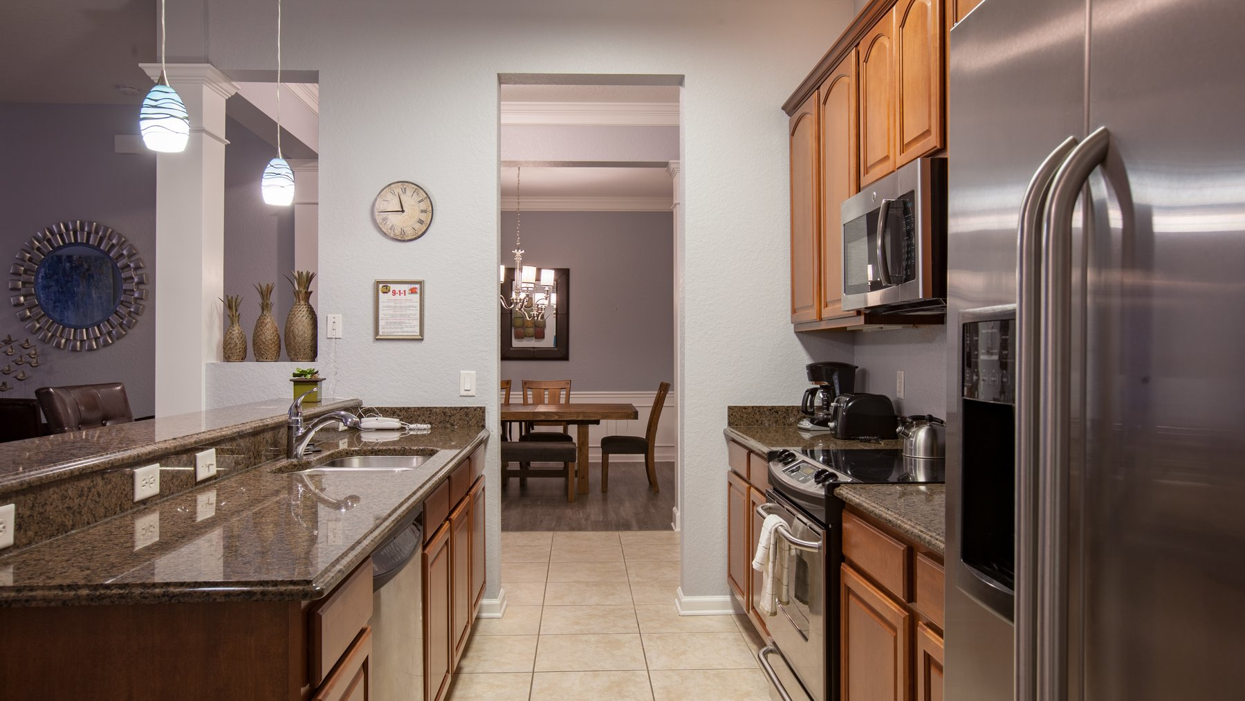 Fully equipped galley style kitchen with stainless steel appliances