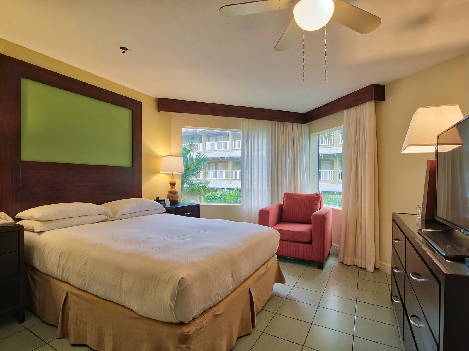 jr suite garden view room with one king bed at Fiesta Resort