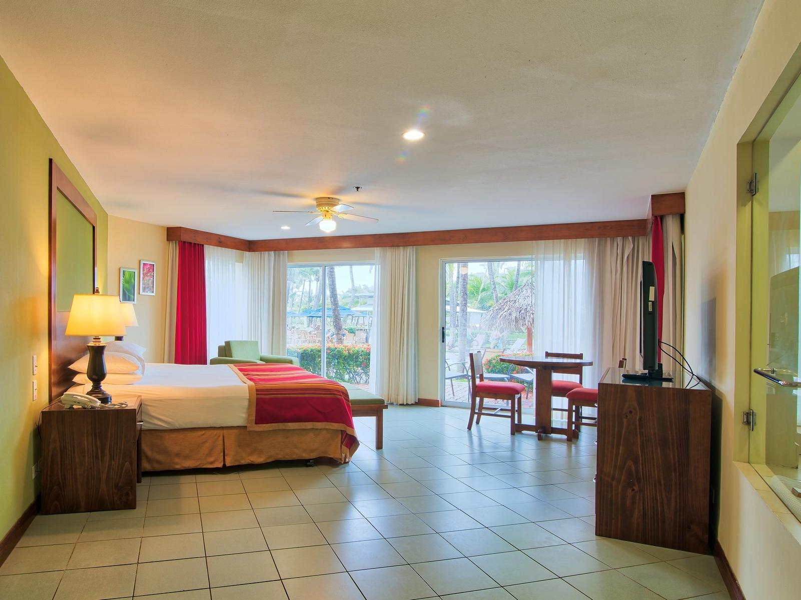 The Family Luxury room with one king bed at Fiesta Resort