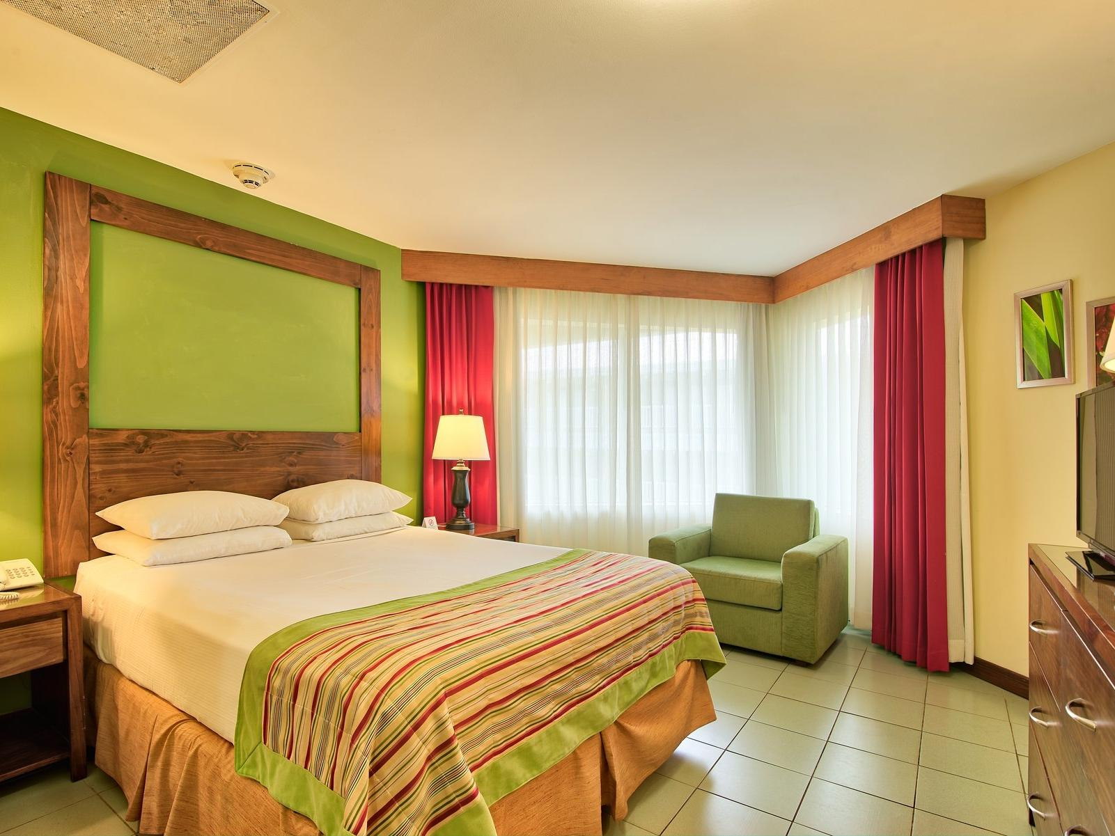 Beautiful family one queen bed with green decoration at Fiesta Resort