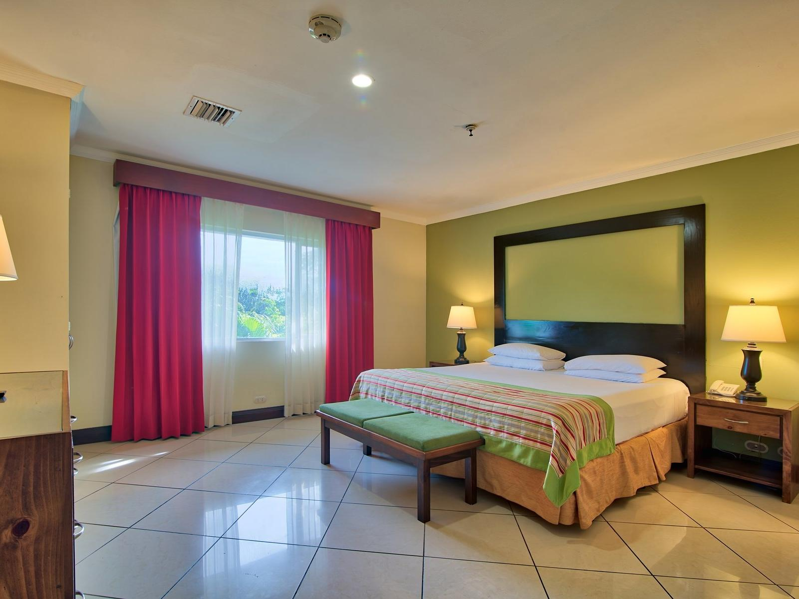 The Family master room with one king bed at Fiesta Resort
