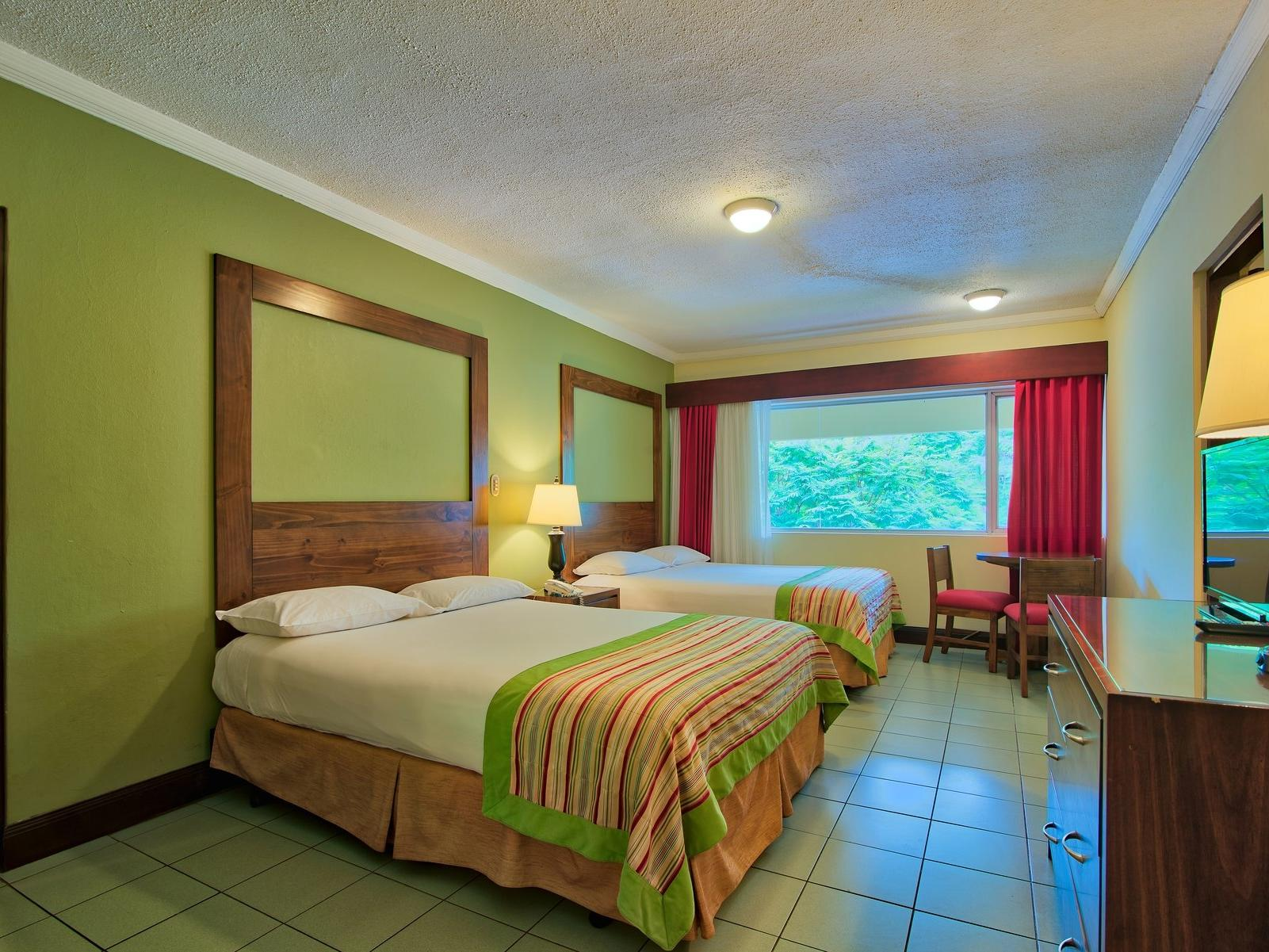 Royal Family Suite with 2 double beds and sofa bed at Fiesta Resort