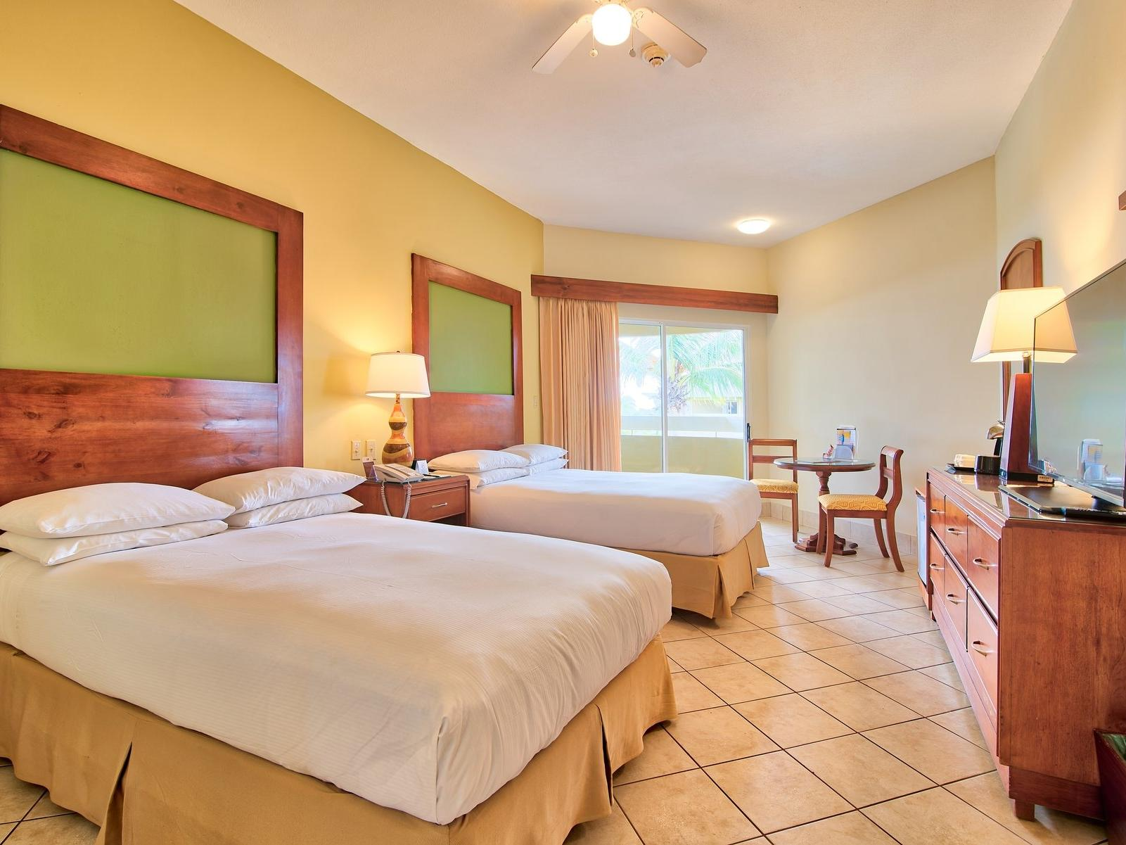 Royal ocean view 2 double bed with tv facility at Fiesta Resort