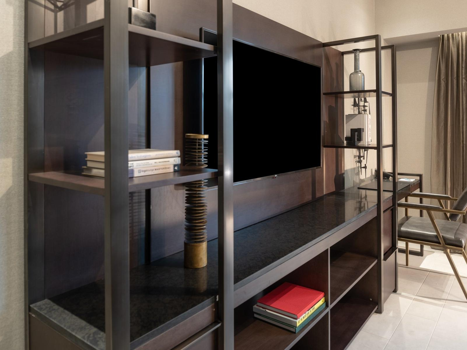 TV unit with books on shelves