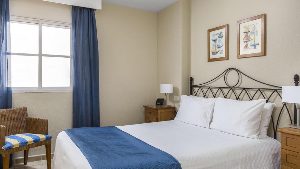 One Bedroom Apartment Bed at Los Amigos Beach Club