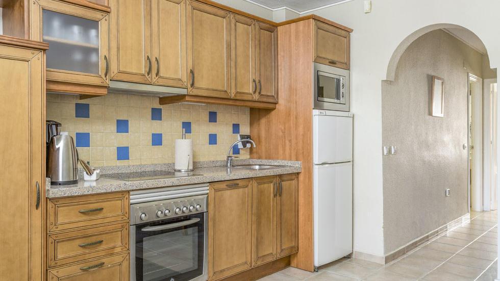 One Bedroom Apartment Kitchen at Los Amigos Beach Club