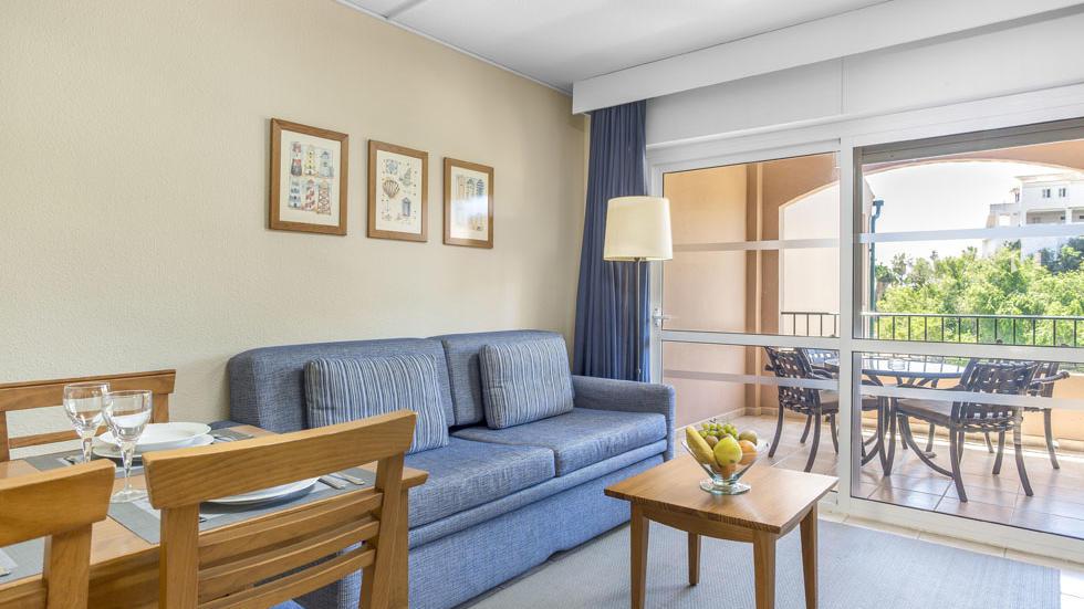 One Bedroom Apartment Couch at Los Amigos Beach Club