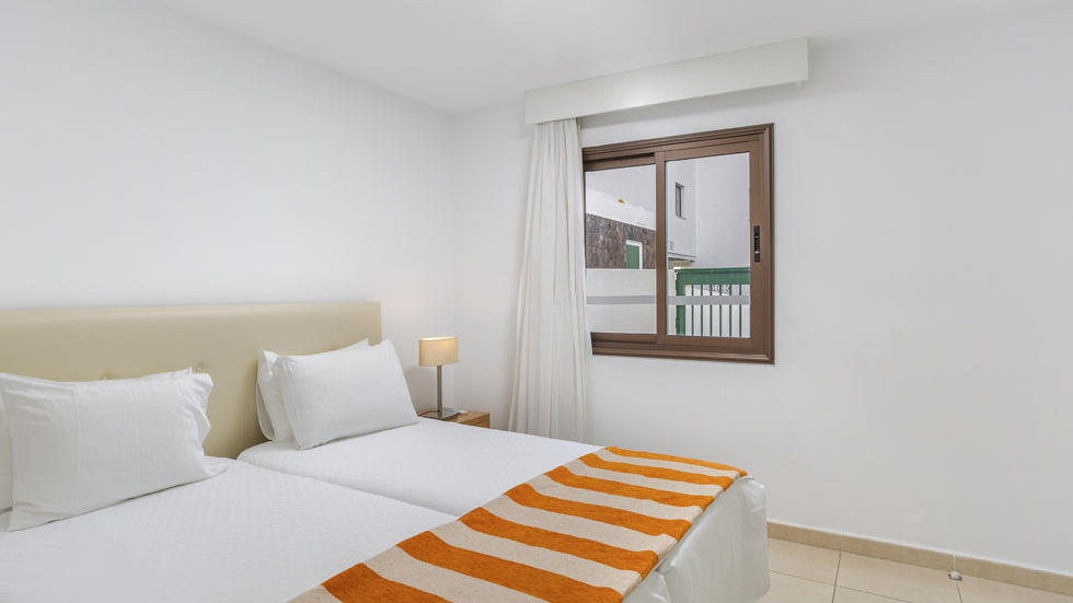 One Bedroom Apartment Bed at Sunset Bay Club