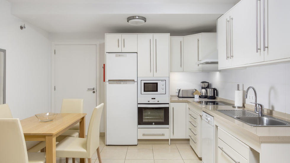 One Bedroom Apartment Kitchen at Sunset Bay Club