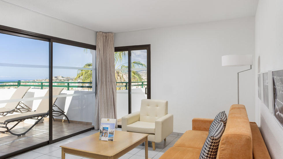 One Bedroom Apartment Living Room Terrace at Sunset Bay Club