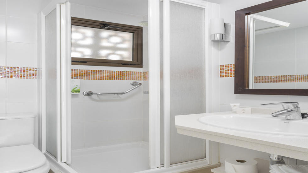Two Bedroom Apartment Bathroom Shower at Sunset Bay Club
