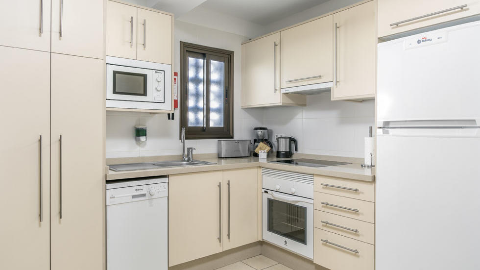 Studio Apartment Kitchen at Sunset Bay Club