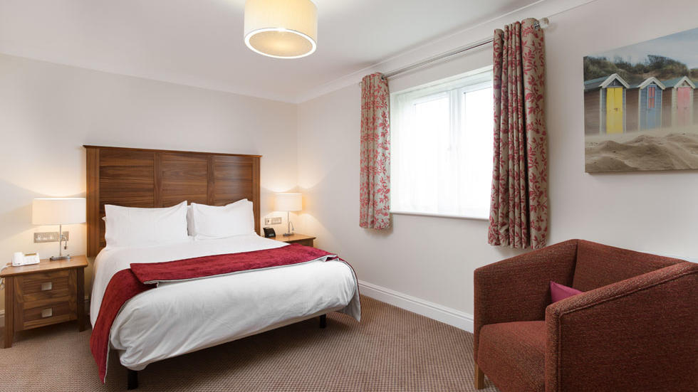 Two Bedroom House King Bed at Woodford Bridge Country Club