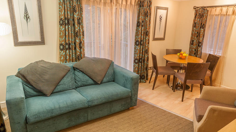 One Bedroom Apartment Couch at Woodford Bridge Country Club