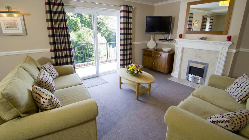 Two Bedroom House Living Room at Woodford Bridge Country Club