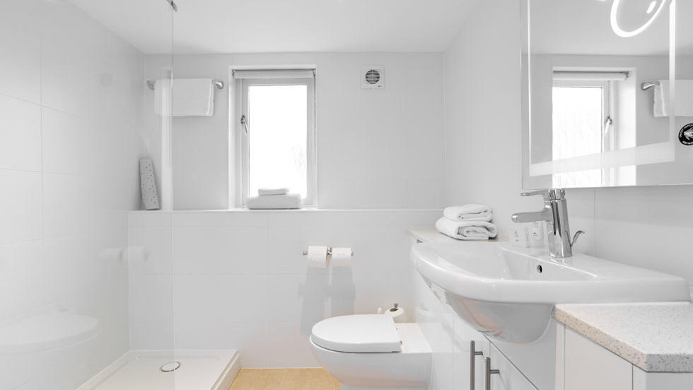 Two Bedroom House Bathroom at Woodford Bridge Country Club