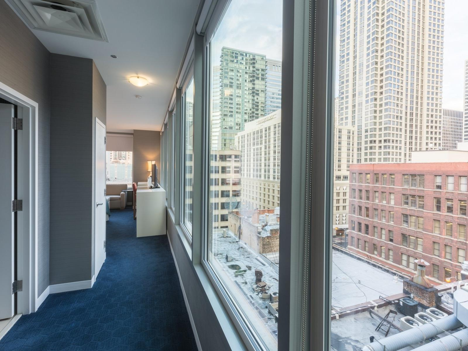 hallway with window overlooking city