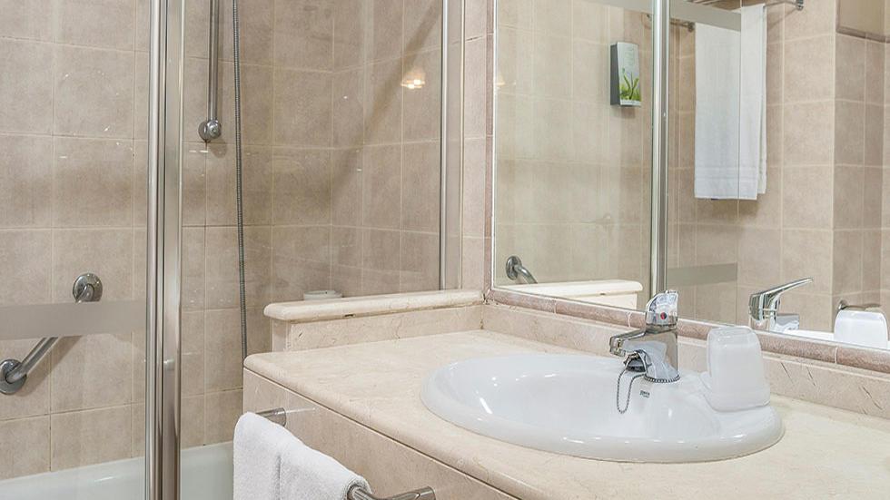One Bedroom Apartment Bathroom at Los Amigos Beach Club