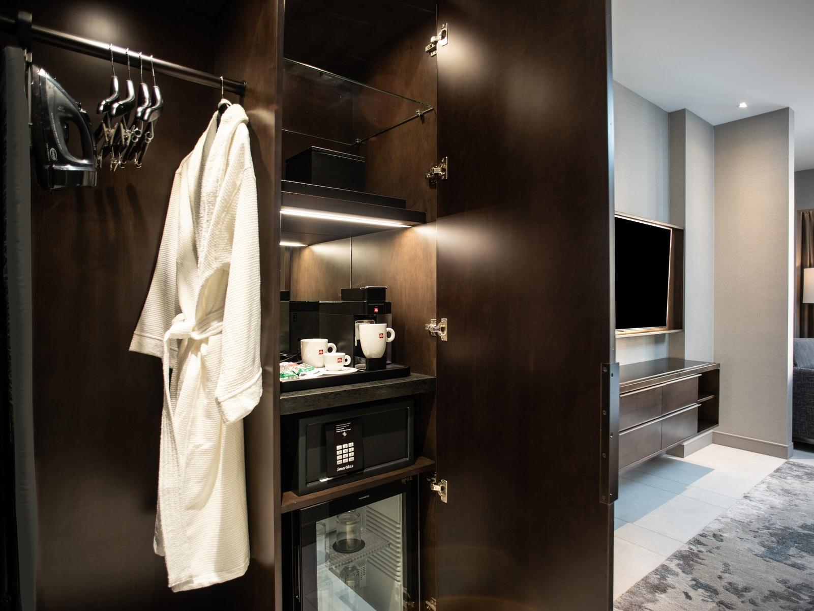 Wardrobe with robe hanging up and