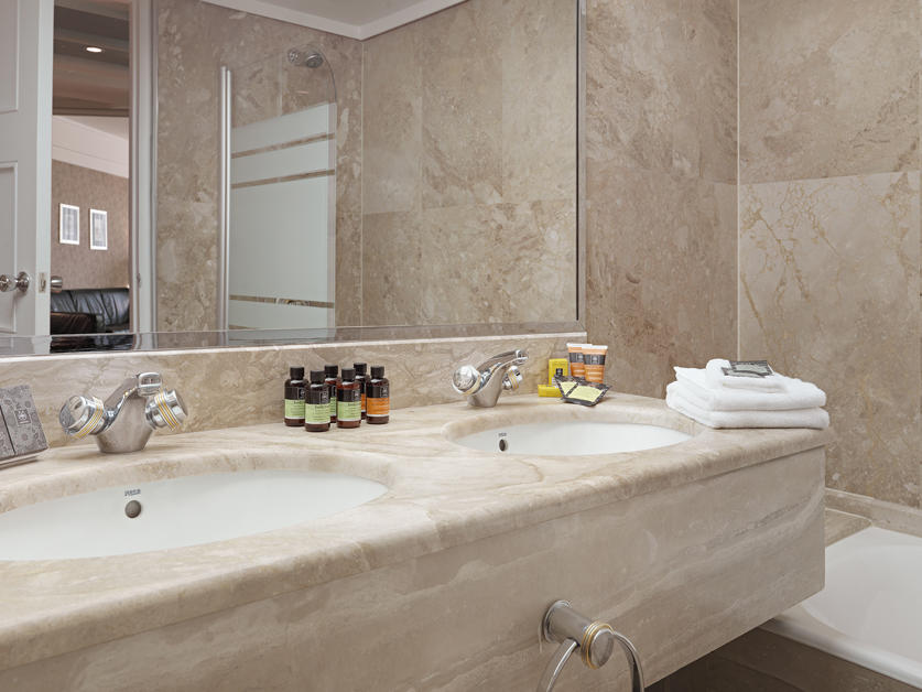deluxe city view suite bathroom at NJV Athens Plaza hotel