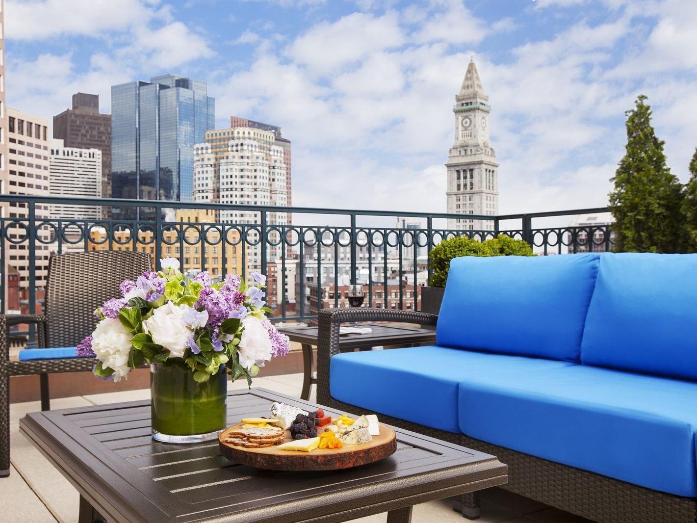 Floral arrangement on patio table with city skyline view