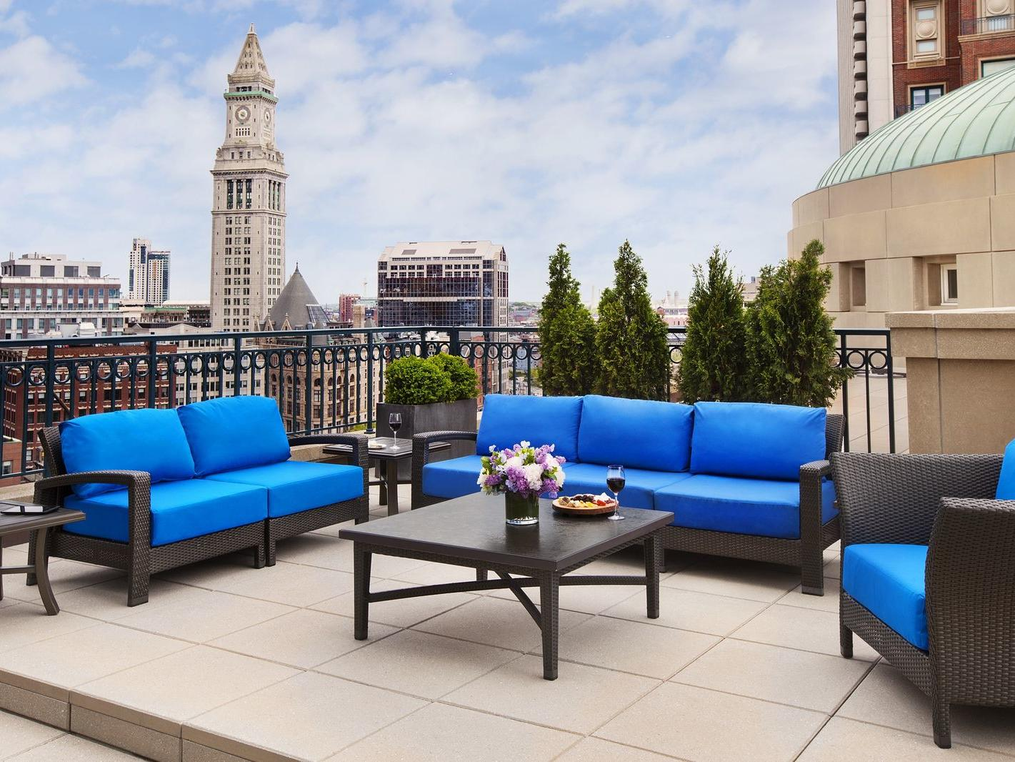 Outdoor furniture on patio with city skyline view