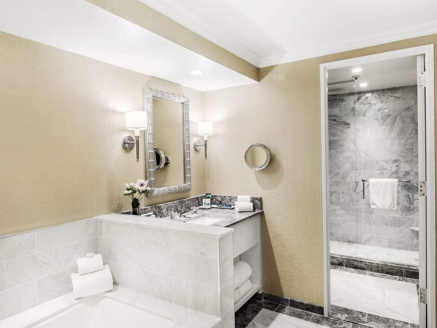 Guest bathroom with tub, walk in shower and vanity
