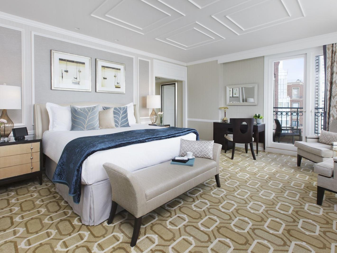 Presidential Suites bedroom with king bed and accent chairs