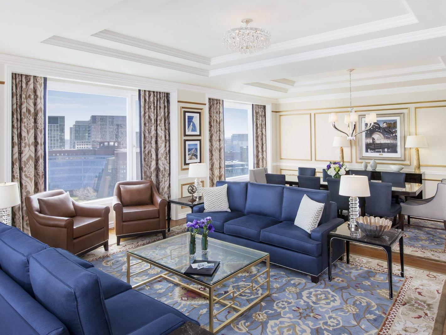 Suite living room and dining area with harbor view