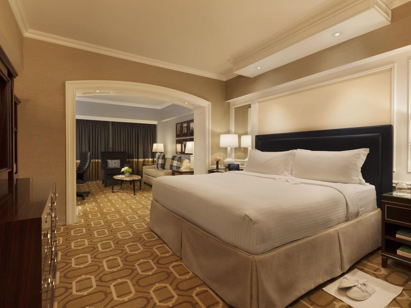 Plush king bed and seating area