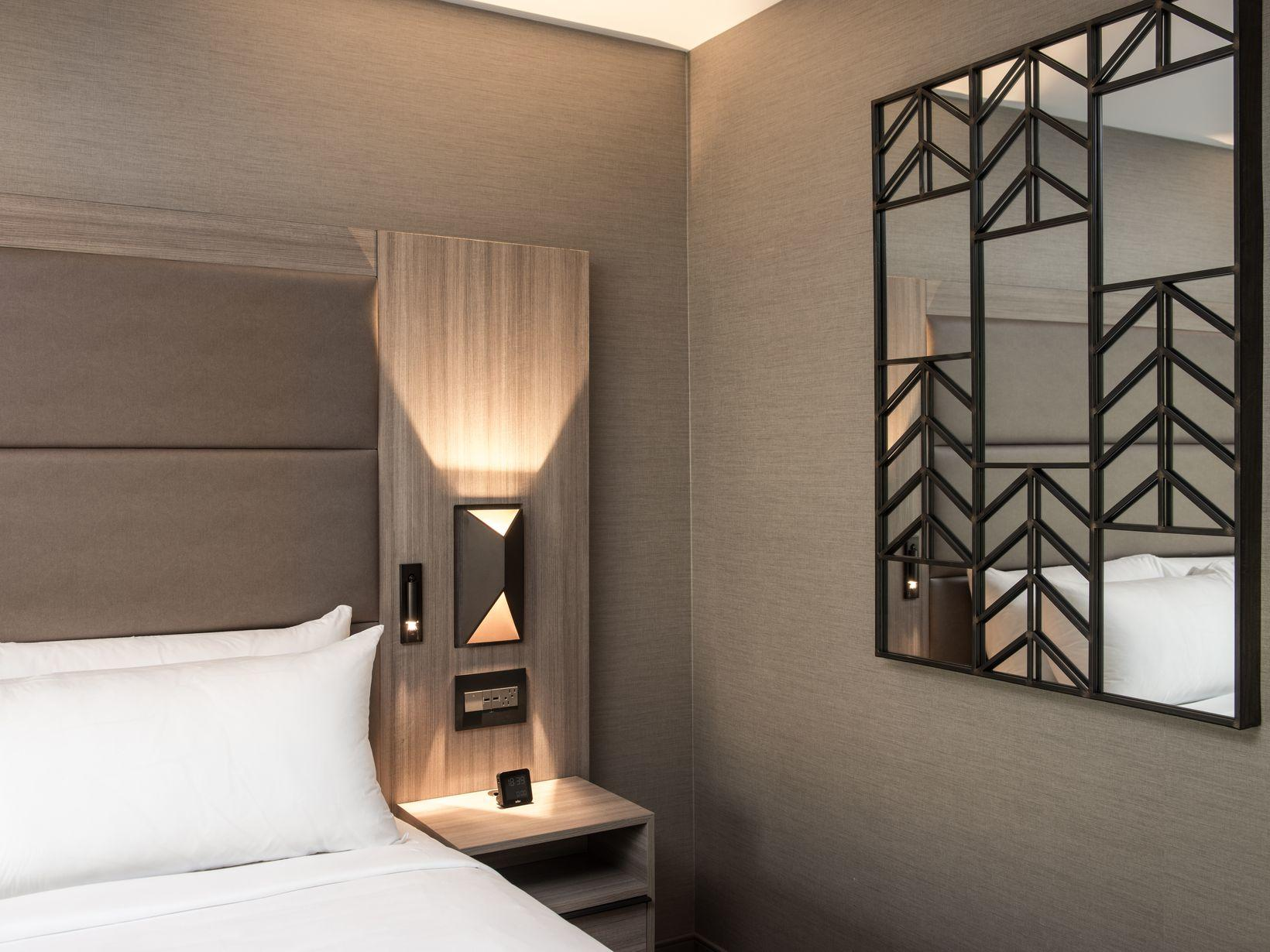 King bed and decorative mirror on wall