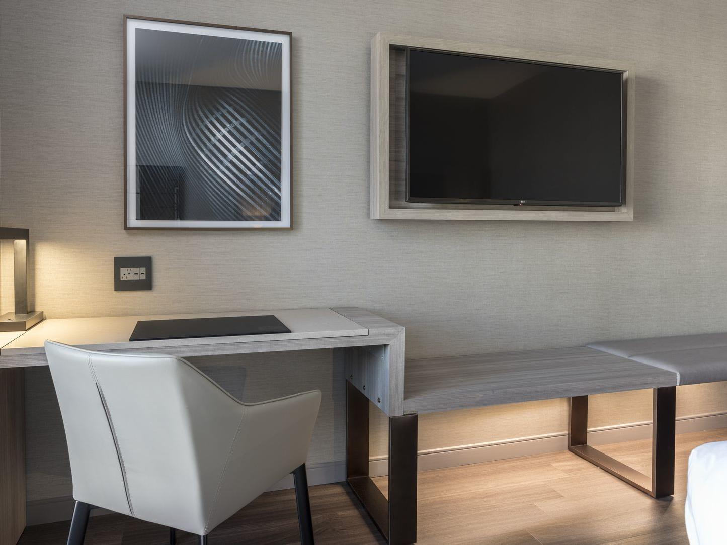 Desk and chair with wall mounted TV