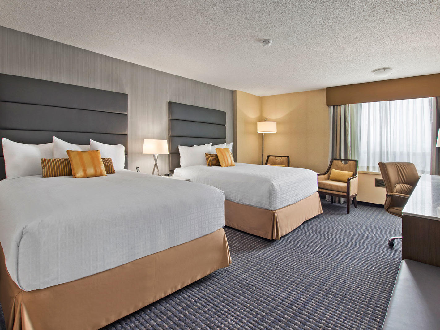 two beds in modern hotel room