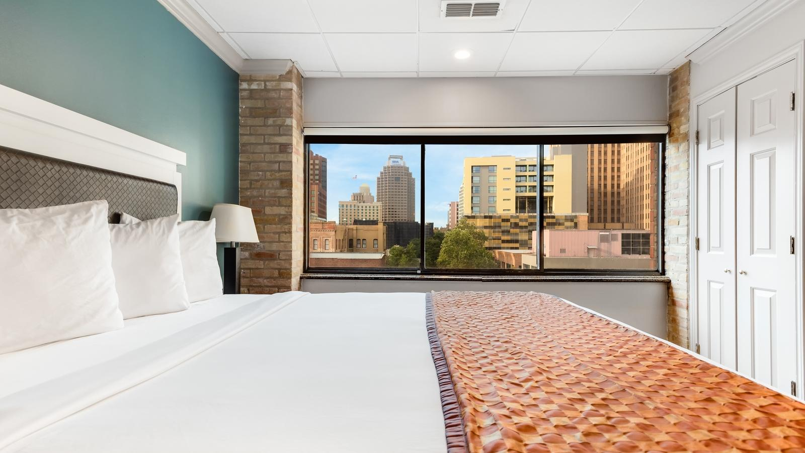 King bed with city view from window