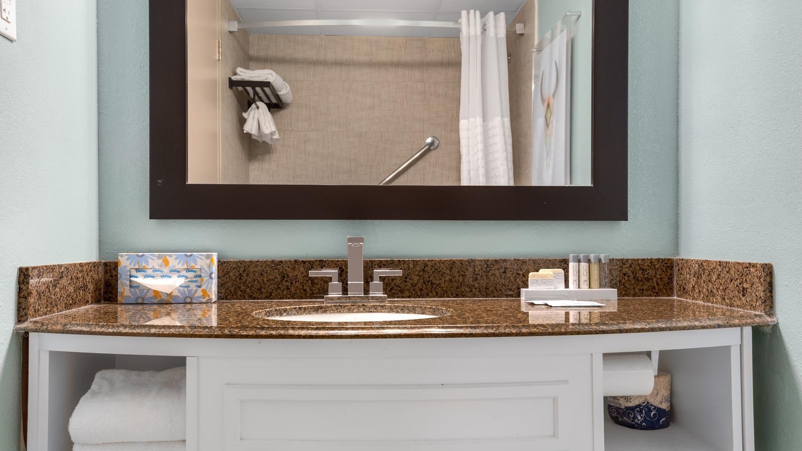 Bathroom vanity with bath amenities