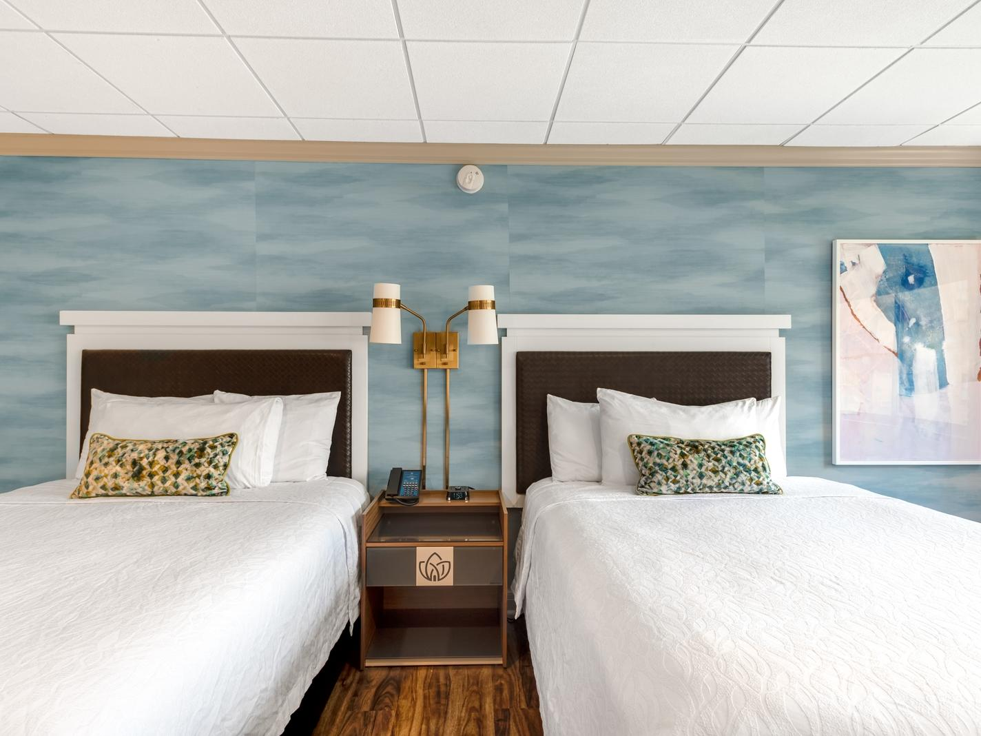 Two guest beds with lamp on nightstand