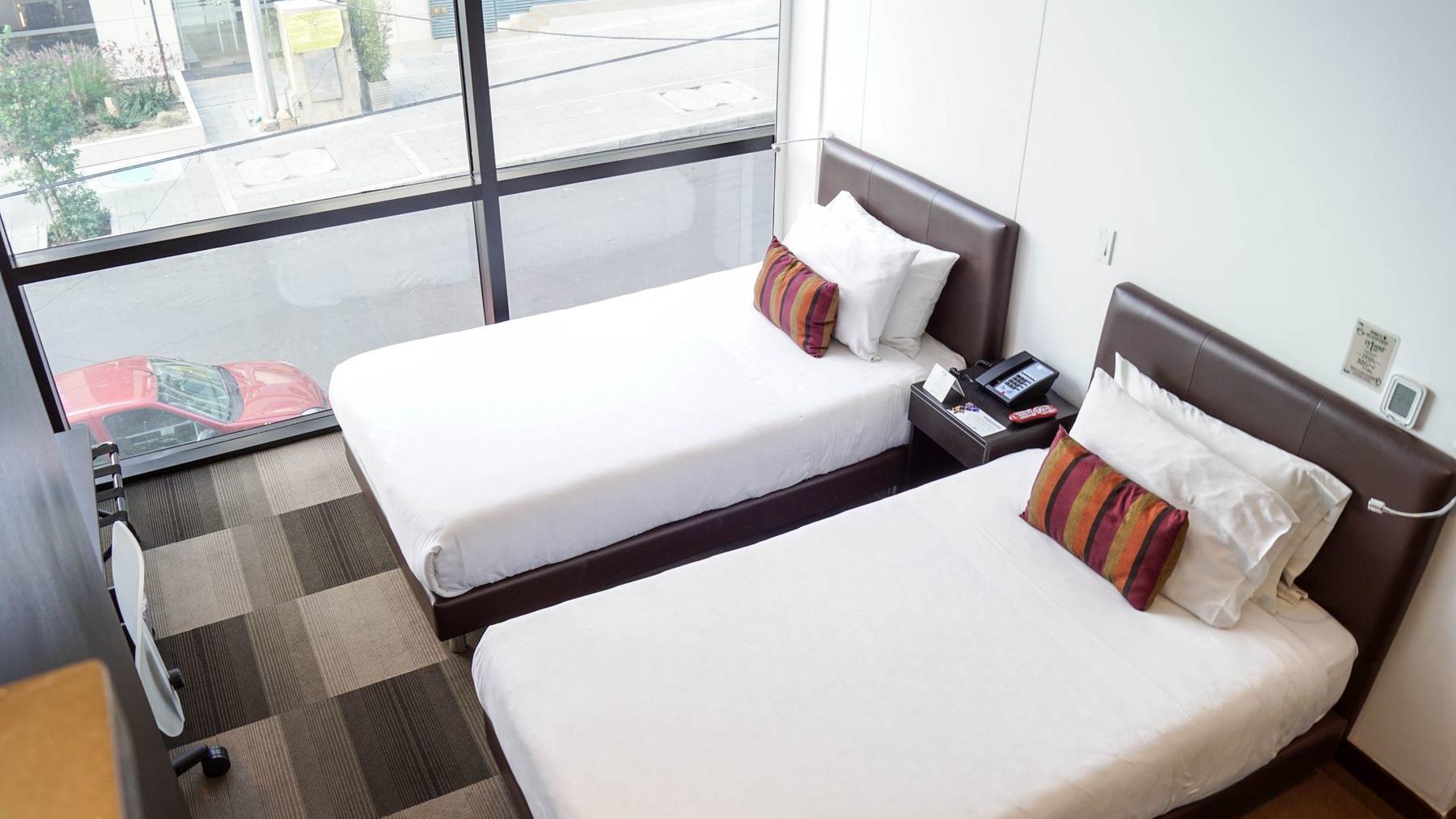 Habitación para dos personas en cama individual sencilla en Bogotá, Usaquén