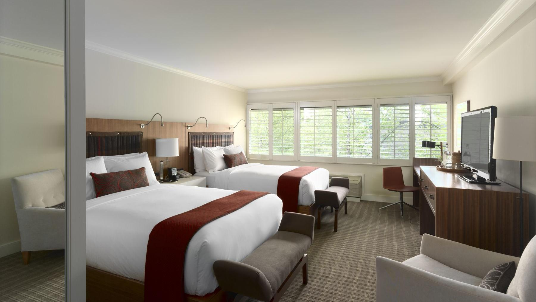 Deluxe hotel room with two double beds