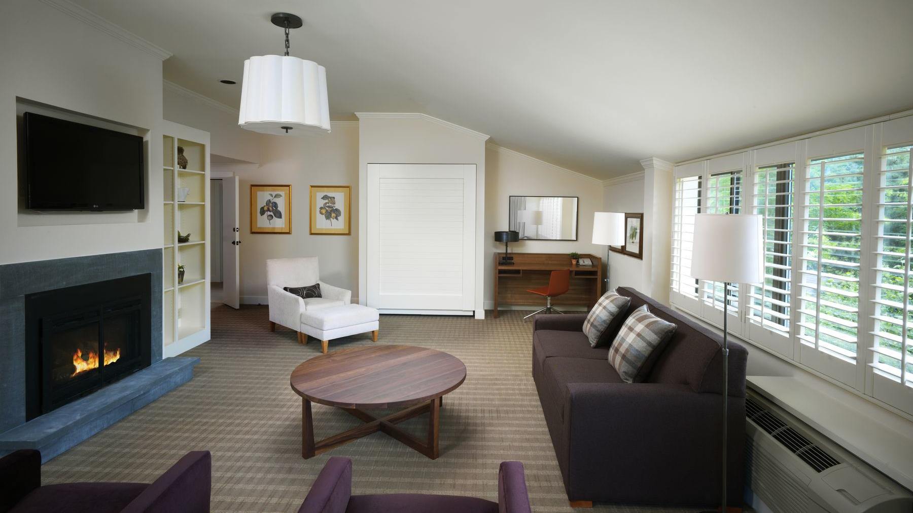 Broad living space of hotel suite.