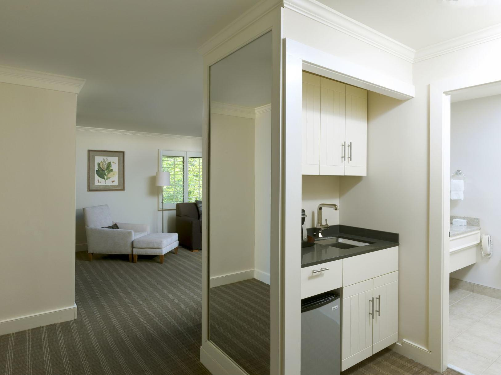 Living space and bathroom of hotel suite.