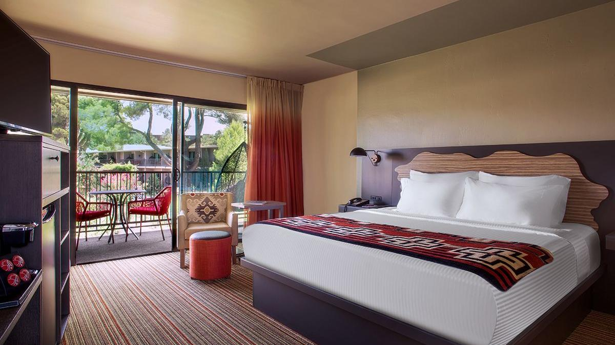 Hotel room with king bed & courtyard view.