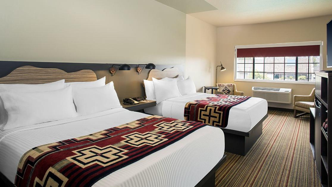 Hotel room with two queen beds.