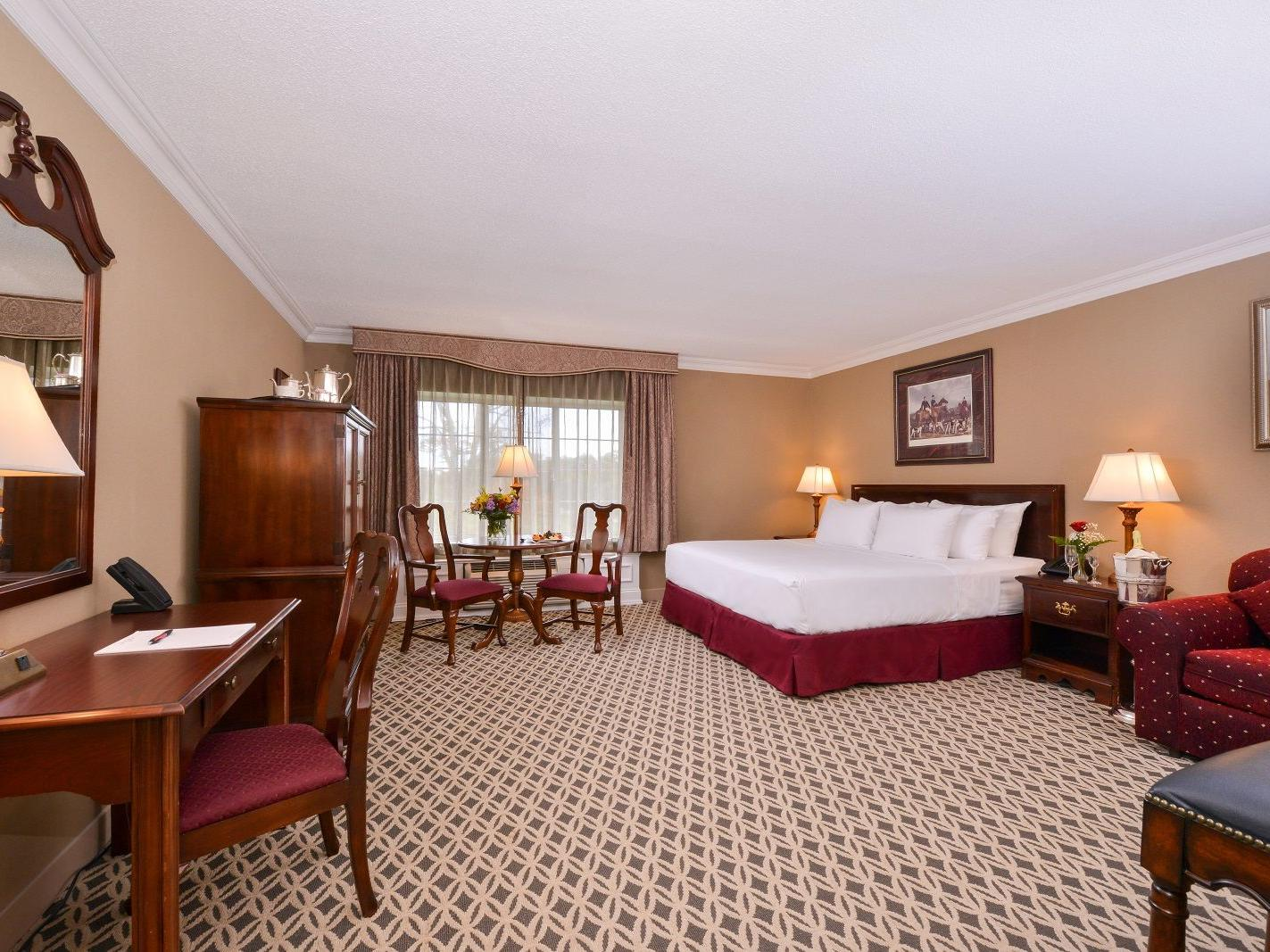 Deluxe hotel room with king bed and work desk